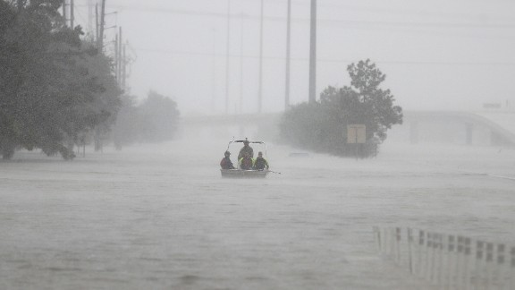 Members of the Texas Border Patrol bring their boat back to the launch site near Deerbrook Mall, on FM 1960, after currents were too rough to transport an elderly woman, needing rescue from behind the mall, as heavy rains continued falling from Tropical Storm Harvey, Tuesday, Aug. 29, 2017, in Humble, Texas. (Karen Warren/Houston Chronicle via AP)