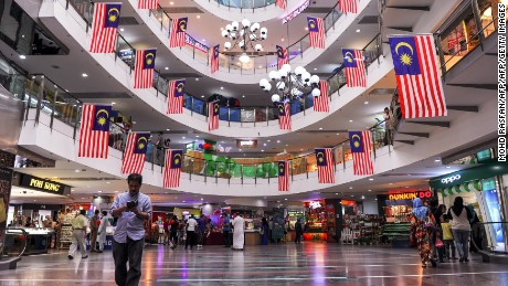 Malaysian national flags are seen hanging in a shopping mall ahead of the country's independence day in Ampang on August 21, 2015.