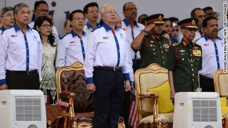 From front L-R: Malaysian Deputy Prime Minister Ahmad Zahid Hamidi, Prime Minister Najib Razak, and King Abdul Halim Mu'adzam Shah observe the national anthem during the 59th National Day celebrations at Independence Square in Kuala Lumpur on August 31, 2016.