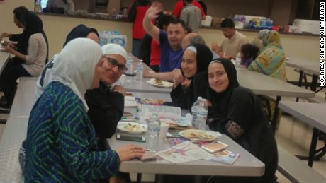 Evacuees eat at the Brand Lane Islamic Center in Stafford, Texas, which is serving as a Hurricane Harvey shelter.