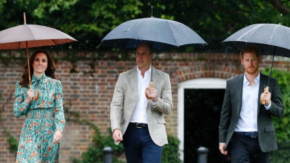 William, Harry and Catherine arrive at the White Garden at Kensington Palace, Princess Diana's home for 15 years, in London on Wednesday. The garden was planted to mark 20 years since her death.