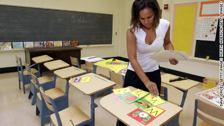 HOUSTON - SEPTEMBER 7:  Ckaris Williams, a teacher and Hurricane Katrina evacuee, prepares her classroom at Douglass Elementary School in Houston September 7, 2005 in Houston, Texas. Douglass was closed for budgetary reasons but the Houston Independent School District reopened the facility for children of evacuees from Hurricane Katrina. Williams taught at Frederick Douglass Elementary on the West Bank in New Orleans prior to the storm. (Photo by Dave Einsel/Getty Images)