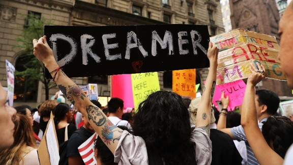NEW YORK, NY - AUGUST 15:  Dozens of immigration advocates and supporters attend a rally outside of  Trump Tower along Fifth Avenue on August 15, 2017 in New York City. The activists were rallying on the five-year anniversary of President Obama's executive order, DACA - Deferred Action for Childhood Arrivals, protecting undocumented immigrants brought to the U.S. as children. Security throughout the area is high with President Donald Trump in residency at the tower, his first visit back to his apartment since his inauguration. Numerous protests and extensive road closures are planned for the area.  (Photo by Spencer Platt/Getty Images)