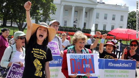 WASHINGTON, DC - AUGUST 30:  Serafina Ha (L) of Chicago and Disciples of Christ Refugee and Immigration Ministries Director Sharon Stanley-Rea lead chants during a demonstration in favor of immigration reform in front of the White House August 30, 2017 in Washington, DC. Organized by The Franciscan Action Network, Disciples Refugee & Immigration Ministries, Church World Service and Sisters of Mercy and the National Korean American Service & Education Consortium, the rally began seven days of prayer and fasting to demand the Trump Administration protect Deferred Action for Childhood Arrivals (DACA) and Temporary Protection Status (TPS). (Photo by Chip Somodevilla/Getty Images)