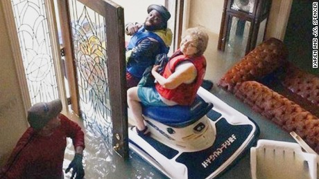 Karen Spencer being rescued from her Houston home on August 28, 2017.