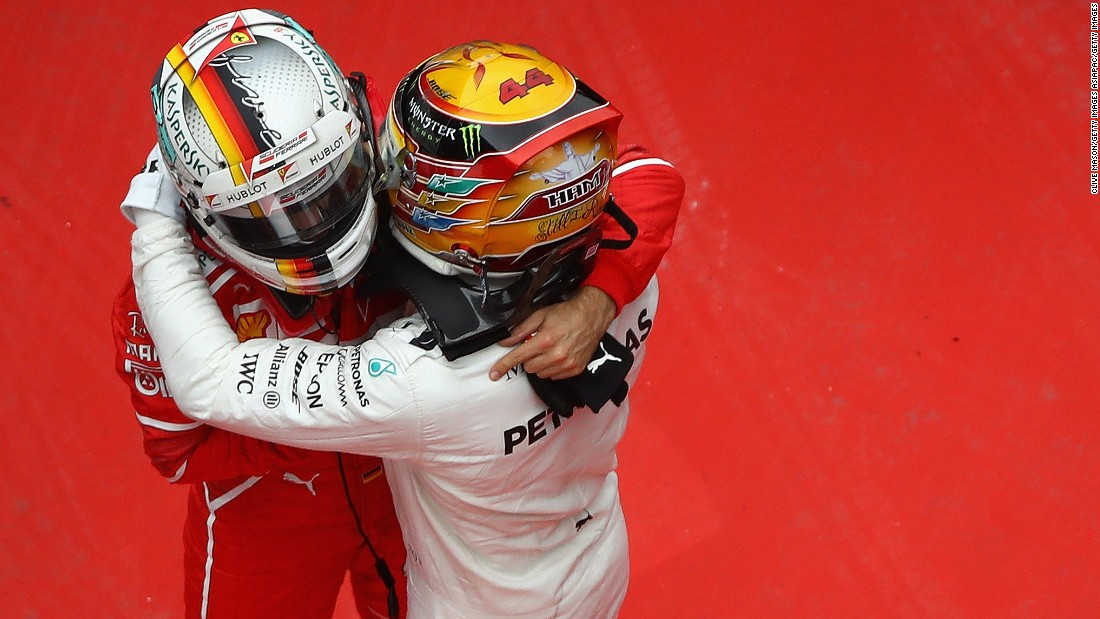 Hamilton and Sebastian Vettel embrace at the 2017 Chinese Grand Prix. The season looked set to go down to the wire until Hamilton stormed to five wins in six races during August, September and October, ending Vettel and Ferrari's hopes of glory.