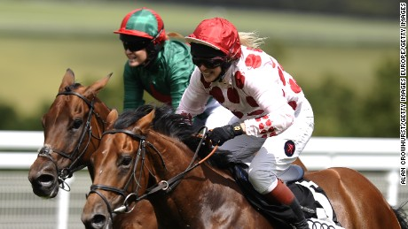CHICHESTER, ENGLAND - AUGUST 02: Philippa Holland riding Beat The Bell (R) win The Magnolia Cup Charity Race at Goodwood racecourse on August 02, 2012 in Chichester, England. (Photo by Alan Crowhurst/Getty Images)