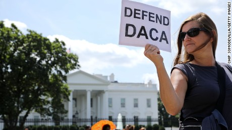About 20 protesters demonstrate to demand immigration reform in front of the White House August 30, 2017 in Washington, DC.