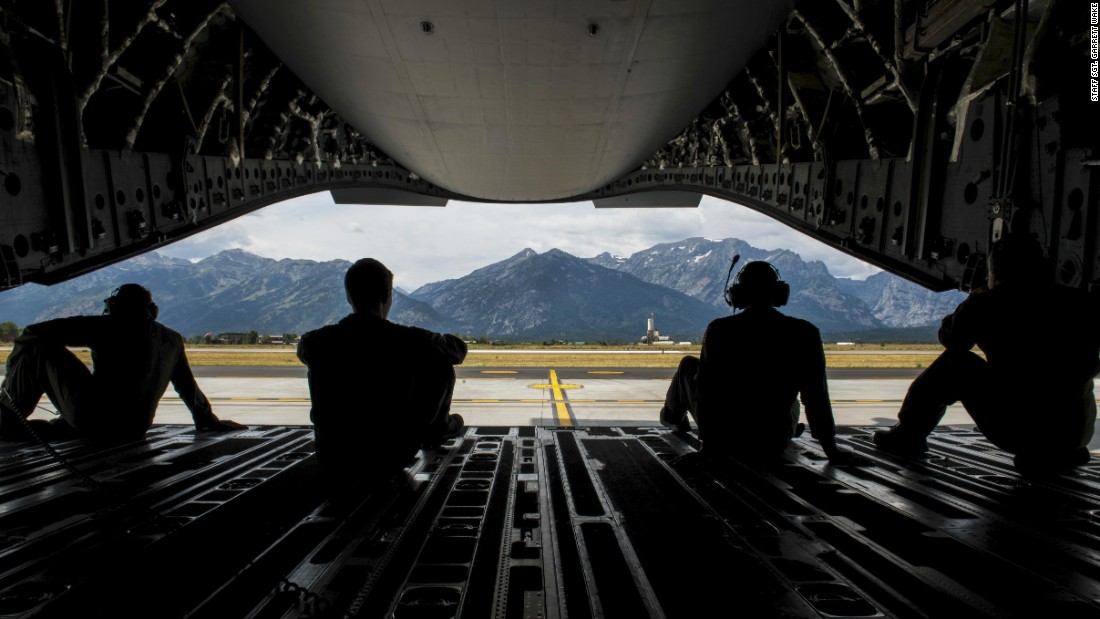 Airmen look out at the Teton Range as their C-17 finishes refueling in Wyoming on Wednesday, August 23.