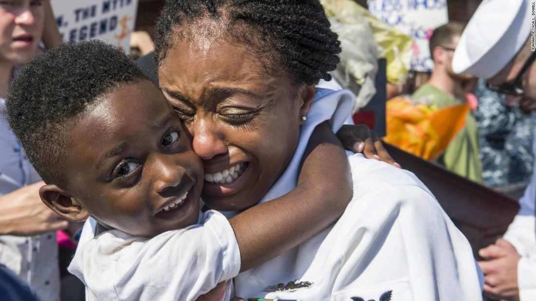 Navy Petty Officer 2nd Class Amanda Odukwu greets her family in Norfolk, Virginia, after returning from a seven-month deployment aboard the USS George H.W. Bush on Monday, August 21.