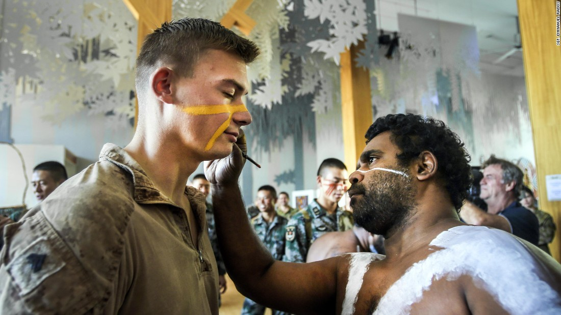An Australian applies face paint to US Marine Cpl. Micheal Smith in Cairns, Australia, on Wednesday, August 23. US troops were participating in exercises to become more familiar with the country's indigenous culture.