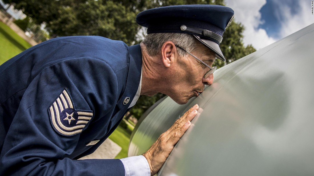 Air Force Tech. Sgt. Robert Wegeman kisses an F-106A Delta Dart, which is now a static display at Florida's Tyndall Air Force Base, on Friday, August 11. Wegeman, who was crew chief for the aircraft, wanted to give it one final peck before he retired after 41 years of service.
