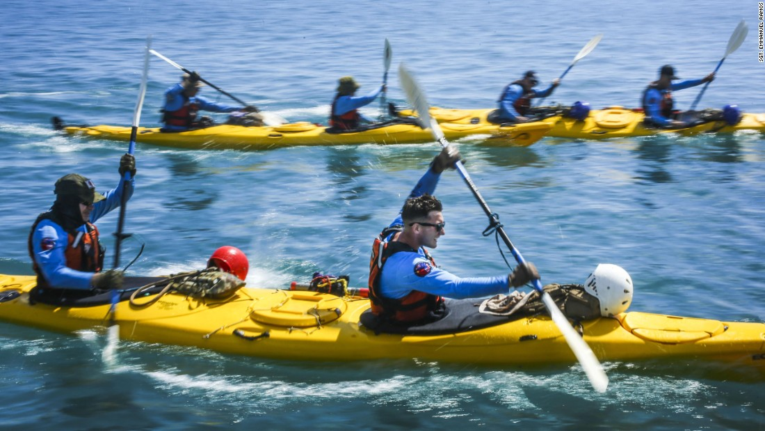 Marine Sgt. John Montgomery, front right, paddles a kayak in Cairns, Australia, during a joint exercise with troops from Australia and China on Thursday, August 24. Troops were paired up from different countries.