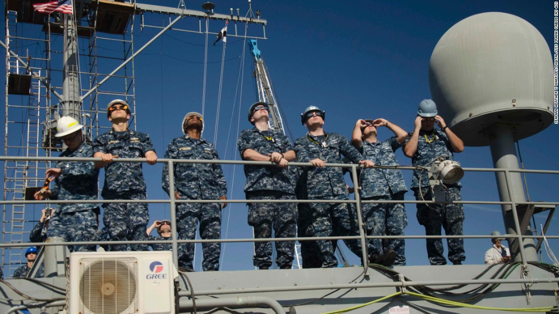 "Sailors assigned to the USS Frank Cable watch the total solar eclipse from Portland, Oregon, on Monday, August 21. <a href=""http://www.cnn.com/interactive/2017/08/us/eclipse-photos/index.html"" target=""_blank"">See more photos from the eclipse</a>"