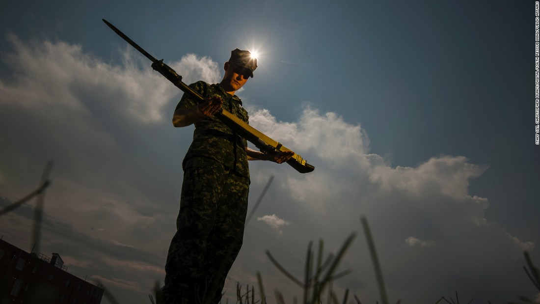 A sailor assigned to the US Navy's Ceremonial Guard trains in Washington during the total solar eclipse on Monday, August 21.