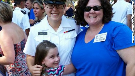 Midshipman Regan Kibby with his younger sister and mother during Plebe Parents' Weekend.