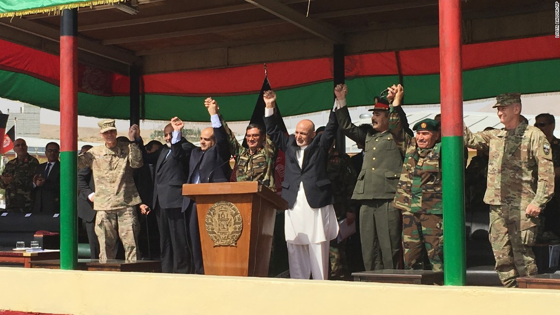 Military leaders from the United States and Afghanistan join Afghan President Ashraf Ghani for the launch of the Afghan Army's new special operations corps on Sunday, August 20.