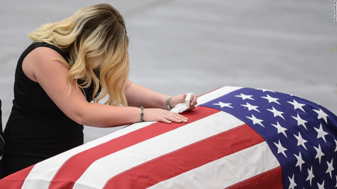 Whitney Hunter weeps over the casket of her husband, Army Sgt. Jonathon Hunter, during his funeral service in Columbus, Indiana, on Saturday, August 26. Jonathon Hunter, 23, was killed in a suicide bombing while serving in Afghanistan.