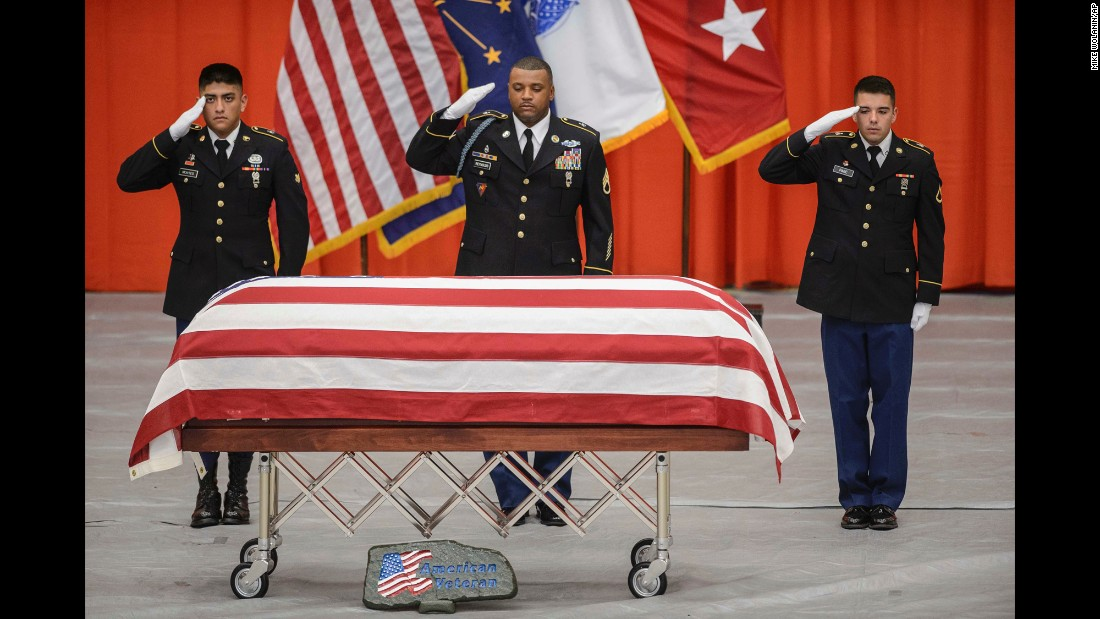 Members of a US Army ceremonial unit salute the casket of Sgt. Jonathon Hunter during his funeral service in Columbus, Indiana, on Saturday, August 26. Hunter, 23, was killed in a suicide bombing while serving in Afghanistan.
