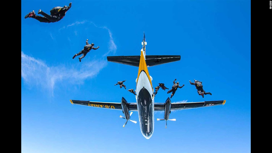 Members of the Golden Knights, the US Army's parachute team, jump out of a plane Thursday, August 17, over the Tobyhanna Army Depot in Pennsylvania.