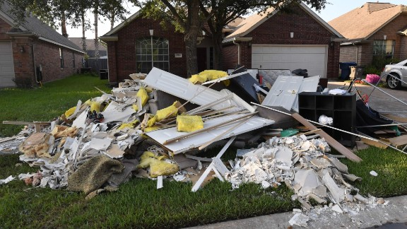 Debris and damaged items sit on the sidewalk after being removed from a home in the Twin Oaks Estate after Hurricane Harvey caused widespread flooding in Houston, Texas on August 31, 2017.   In Houston, America
