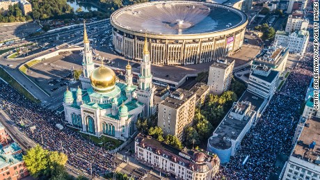An aerial view of Russia's Muslim community praying in a street outside the Central Mosque during Eid al-Adha.