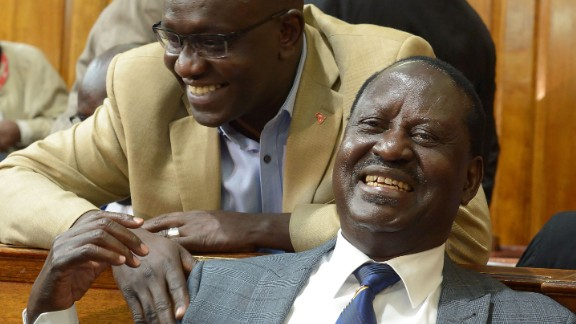 Opposition presidential candidate Raila Odinga, center, reacts to the ruling Friday in Nairobi.