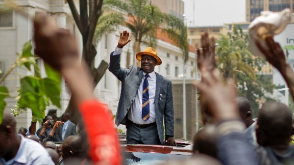 Odinga, the opposition leader, waves to supporters Friday as he leaves the Supreme Court  in Nairobi.