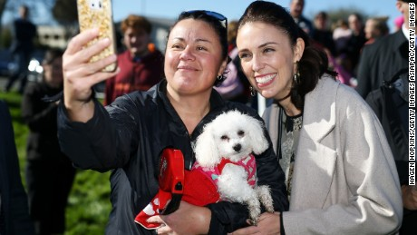 Ardern poses for a photo with a supporter on August 23 in Palmerston North, New Zealand.
