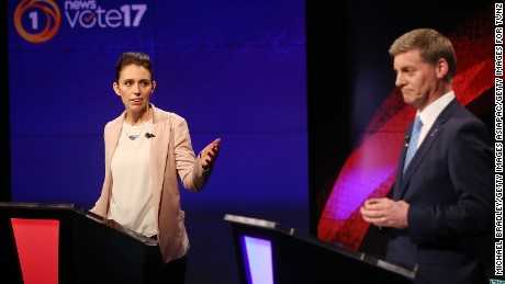 Labour leader Jacinda Ardern (L) and Prime Minsiter and Leader of the National Party Bill English (R) speak during the Vote 2017 1st Leaders Debate on August 31, 2017 in Auckland, New Zealand.