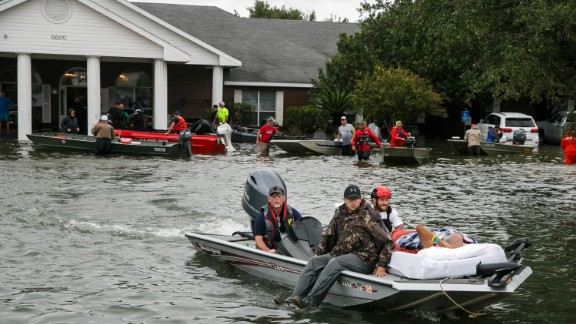 Search and rescue volunteers rescue patients from the flooded Cypress Glen nursing home in Port Arthur, Texas, on August 30.