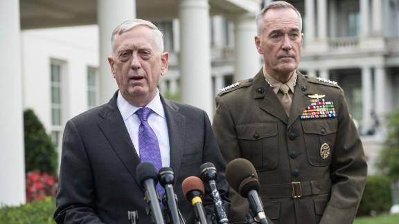 """US Defense Secretary James Mattis (L) speaks to the press with Gen. Joseph Dunford, chairman of the Joint Chiefs of Staff, about the situation in North Korea at the White House in Washington, DC, on September 3, 2017. The US will launch 'massive military response' to any threat from Pyongyang, Mattis said. US President Donald Trump on Sunday denounced North Korea's detonation of what it claimed was a hydrogen bomb able to fit atop a missile, saying the time for """"appeasement"""" was over and threatening drastic economic sanctions. / AFP PHOTO / NICHOLAS KAMM        (Photo credit should read NICHOLAS KAMM/AFP/Getty Images)"""