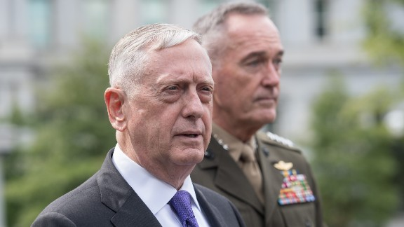 """US Defense Secretary James Mattis (L) and Gen. Joseph Dunford, chairman of the Joint Chiefs of Staff, arrive to speak to the press about the situation in North Korea at the White House in Washington, DC, on September 3, 2017.The US will launch 'massive military response' to any threat from Pyongyang, Mattis said. US President Donald Trump on Sunday denounced North Korea's detonation of what it claimed was a hydrogen bomb able to fit atop a missile, saying the time for """"appeasement"""" was over and threatening drastic economic sanctions. / AFP PHOTO / NICHOLAS KAMM        (Photo credit should read NICHOLAS KAMM/AFP/Getty Images)"""