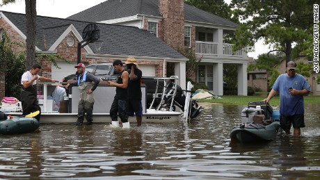 HOUSTON, TX - SEPTEMBER 03:  People use boats to help bring items out of homes in an area where a mandatory evacuation is still under effect after flood water inundated them after torrential rains caused widespread flooding during Hurricane and Tropical Storm Harvey on September 3, 2017 in Houston, Texas. Harvey, which made landfall north of Corpus Christi on August 25, dumped around 50 inches of rain in and around areas of Houston and Southeast Texas.  (Photo by Joe Raedle/Getty Images)