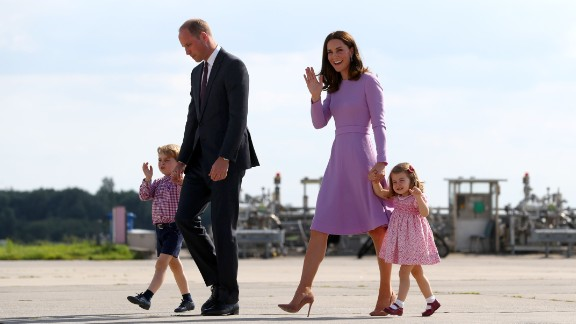 Britain's Prince William, Duke of Cambridge and his wife Kate, the Duchess of Cambridge, and their children Prince George and Princess Charlotte walk on the tarmac of the Airbus compound prior boarding their plane in Hamburg, northern Germany, on July 21,2017.  The British royal couple are on the last stage of their three-day visit to Germany. / AFP PHOTO / POOL / Christian Charisius        (Photo credit should read CHRISTIAN CHARISIUS/AFP/Getty Images)