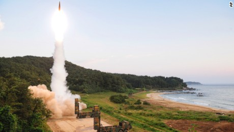 "In this photo provided by South Korea Defense Ministry, South Korea's Hyunmoo II ballistic missile is fired during an exercise at an undisclosed location in South Korea, Monday, Sept. 4, 2017. In South Korea, the nation's military said it conducted a live-fire exercise simulating an attack on North Korea's nuclear test site to ""strongly warn"" Pyongyang over the latest nuclear test. Seoul's Joint Chiefs of Staff said the drill involved F-15 fighter jets and the country's land-based ""Hyunmoo"" ballistic missiles. The released live weapons ""accurately struck"" a target in the sea off the country's eastern coast, the JCS said. (South Korea Defense Ministry via AP)"