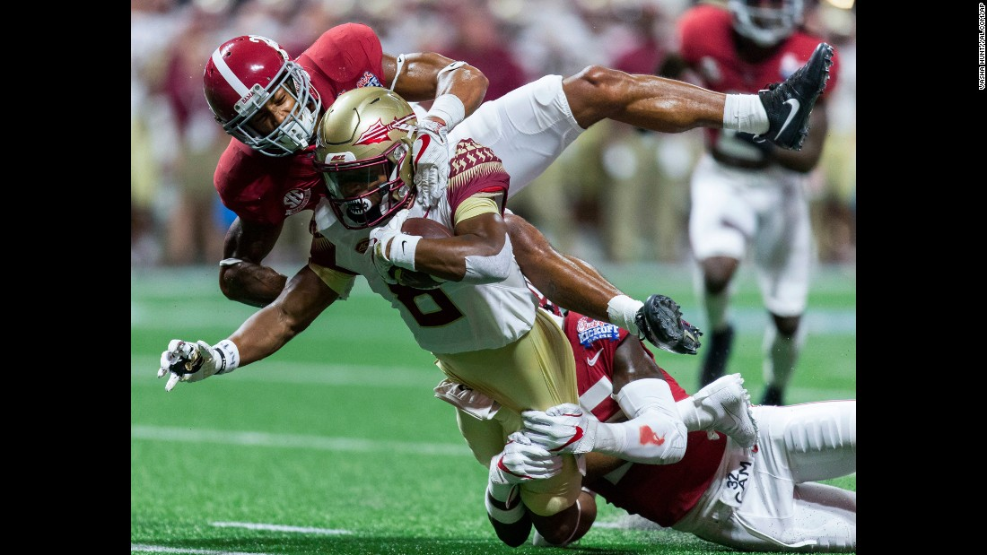 Florida State wide receiver Nyqwan Murray is tackled by Alabama defensive backs Anthony Averett, top, and Shyheim Carter during a college football game in Atlanta on Saturday, September 2. Alabama won 24-7 in what was an opening matchup of two top-ranked teams. Alabama came into the game No. 1 in the country, while Florida State was No. 3.