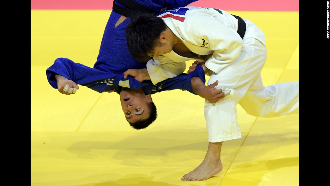 Japan's Hifumi Abe throws Ukraine's Georgii Zantaraia at the World Judo Championships on Tuesday, August 29. Abe defeated Zantaraia in the quarterfinals and went on to win gold in their weight class.