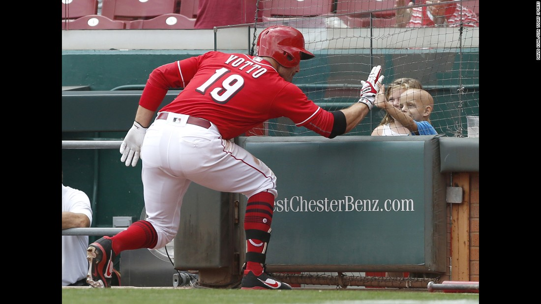 "Cincinnati first baseman Joey Votto high-fives Walter Herbert after hitting a home run against the New York Mets on Thursday, August 31. Walter, <a href=""https://www.usatoday.com/story/sports/mlb/2017/08/31/reds-joey-votto-superbubz-walter-herbert-home-run/621821001/"" target=""_blank"">a 6-year-old battling cancer,</a> also received a bat and a jersey from Votto after the home run."