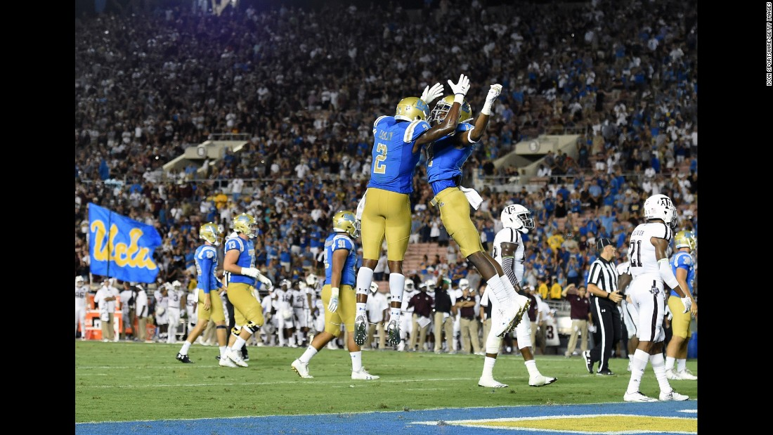 "UCLA wide receivers Jordan Lasley, left, and Theo Howard celebrate a fourth-quarter touchdown during the Bruins' <a href=""http://bleacherreport.com/articles/2731294-josh-rosen-ucla-erase-34-point-deficit-to-shock-texas-am-45-44"" target=""_blank"">spectacular comeback against Texas A&M</a> on Sunday, September 3. UCLA trailed 44-10 with two minutes left in the third quarter, but it rallied to win 45-44. Lasley caught the game-winning touchdown with 43 seconds left."