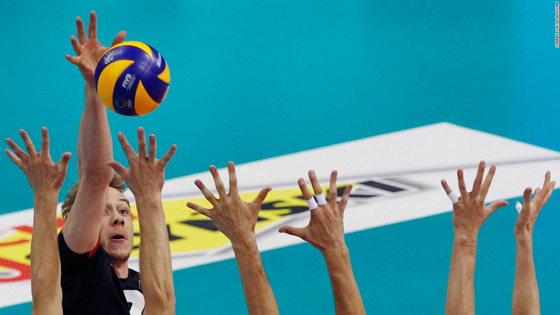 Belgium's Sam Deroo tries to spike the ball past Serbian blockers on Sunday, September 3. It was the third-place game at the European Volleyball Championship, and Serbia won in five sets. Russia won the tournament for the 14th time.