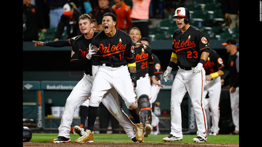 The Baltimore Orioles celebrate after Jonathan Schoop, not pictured, hit a walk-off double to beat Toronto in the 13th inning on Friday, September 1.