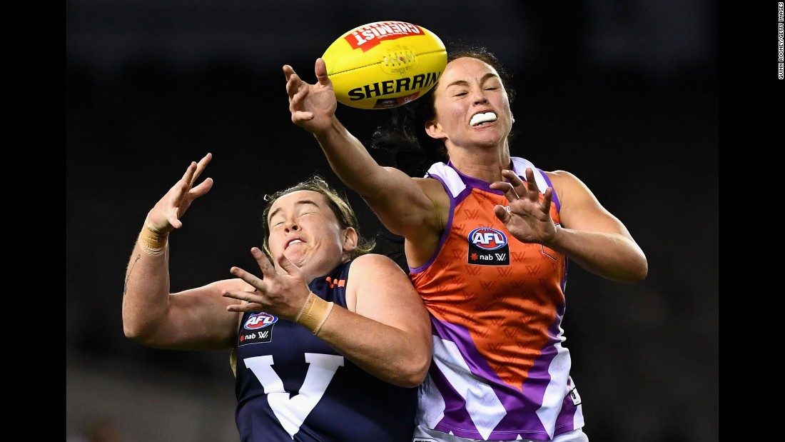 Sarah Perkins, left, and Leah Kaslar compete for a ball during an Australian rules football match in Melbourne on Saturday, September 2. Perkins' Victoria team defeated Kaslar's Allies by 97 points.