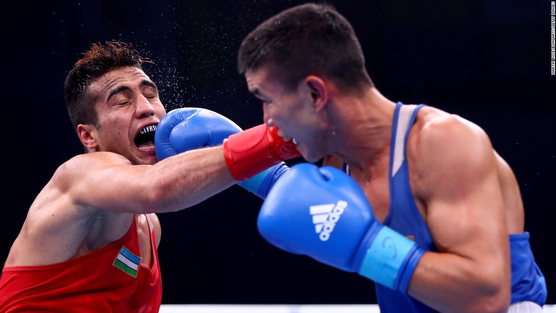 Shakhram Giyasov, a boxer from Uzbekistan, takes a punch from Kazakhstan's Ablaikhan Zhussupov during a welterweight bout in Hamburg, Germany, on Friday, September 1. Giyasov defeated Zhussupov in what was a semifinal match at the AIBA World Boxing Championships. Giyasov went on to win the gold medal. Zhussupov got the bronze.