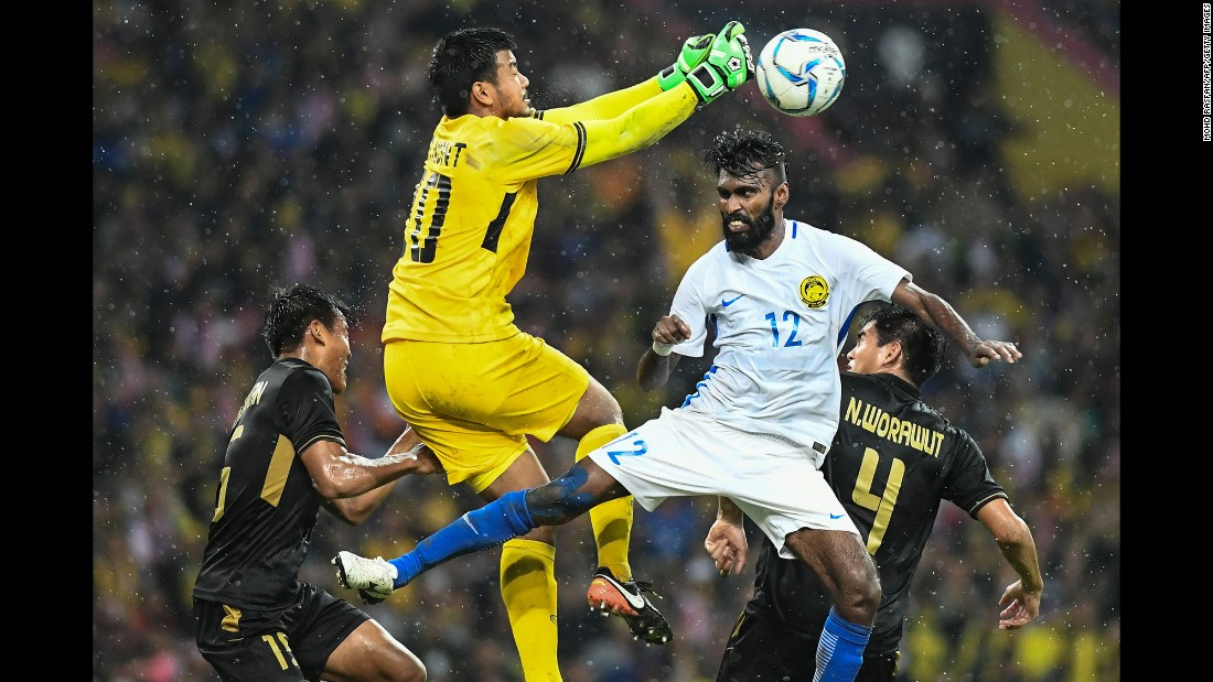 Thai goalkeeper Nont Muangngam punches the ball past Malaysia's Thanabalan Nadarajah during the final of the Southeast Asian Games on Tuesday, August 29. Thailand won 1-0.