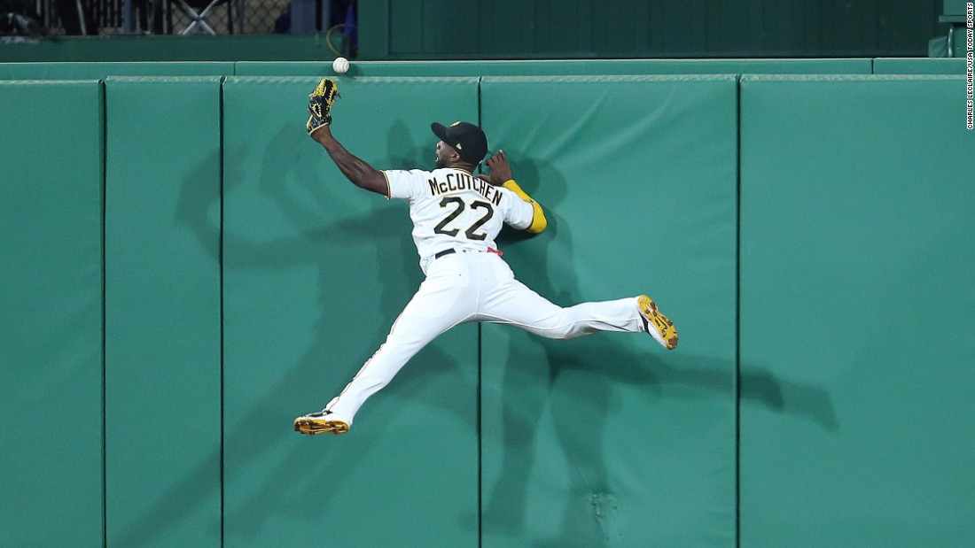 Pittsburgh center fielder Andrew McCutchen leaps into the wall but can't make the catch during a game against Cincinnati on Friday, September 1.