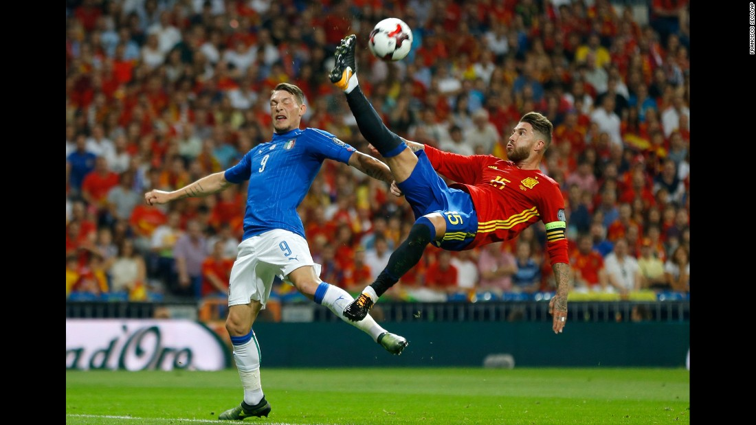 Spanish defender Sergio Ramos clears the ball near Italy's Andrea Belotti during a World Cup qualifier on Saturday, September 2. Spain won the match 3-0 in Madrid.
