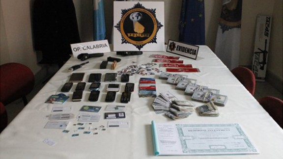 """Italian mobster Rocco Morabito's arsenal of ID cards, credit cards and cell phones. The so-called """"King of Cocaine"""" was arrested after evading authorities for more than 20 years."""