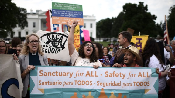 Immigrants and supporters demonstrate holding signs during a rally in support of the Deferred Action for Childhood Arrivals (DACA) in front of the White House in Washington DC on September 5.