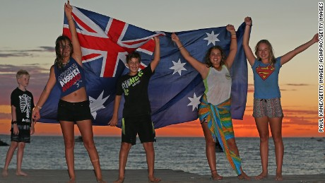 Children display an Australian flag at Bathers Beach on Australia Day, 2017.